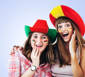 Two happy screaming girls - football fans — Stockfoto