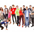 Stock Photo: Large group of happy multicolored dressed teenagers on white