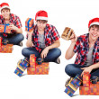 Cheerful young man dressed in santa hat found gift in box — Stock Photo #35813747