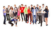 Large group of happy multicolored dressed teenagers on the white — Stockfoto