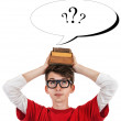 Comic schoolboy photo with books on the head and question marks — Stock Photo