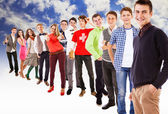 Large group of happy multicolored dressed teenagers — Stock Photo