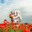 Mother with little son on the poppies field — Stock Photo #36631953