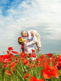 Mother with little son on the poppies field — Foto de Stock
