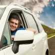 Man driving his car on the lonely road — Stock Photo #38762691