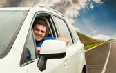 Man driving his car on the lonely road — Stock Photo