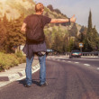 Hitchhiking traveler on road — Stock Photo #39092207