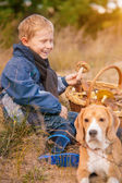 Happy Smiling boy on autumn forest glade — Stock Photo