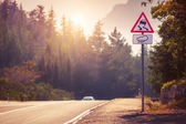 Mountain tortuous road in sunset time — Stock Photo