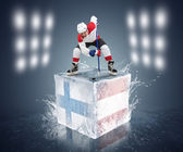 Hockey player on the cube with Finland and Austria flags — Stock Photo