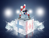 Finland - Canada game. Face-off player on the ice cube. — Stock Photo