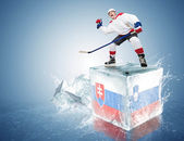 Slovakia - Slovenia game. Spunky hockey player on ice cube — Stock Photo
