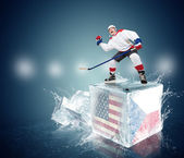 Screaming hockey player on ice cubes . — Stock Photo