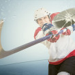 Ice hockey puck hit opponent visor — Stock Photo #41195233