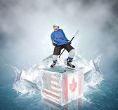 Screaming hockey player on abstract ice cubes background — Stock Photo