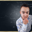 Thoughtful guy on school board background — Stock Photo #41665751