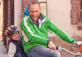 Father with little son cycling together  — Stock Photo
