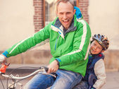 Emotional portrait father with cycling by bicycle together — Stock Photo