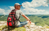 Mountain hiker relax on the top of mountain — Stock Photo