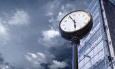 Clock at business building — Stock Photo