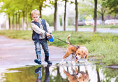 Little boy walk with his pet — Stock Photo