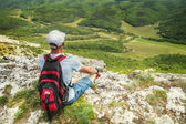 Man hiker on top of a mountain — Stock Photo