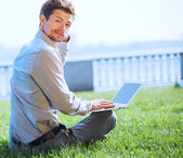 Man surfing  internet pages outdoor — Stock Photo