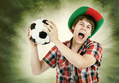 Portuguese fan loudly shouts — Stock Photo