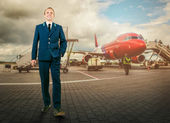 Man in aircraft uniform on airport area — Stock Photo