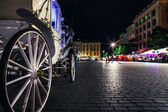 Carriage wheel on main square — Foto Stock