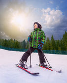 Little skier in mountain sky resort — Zdjęcie stockowe