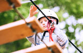 Boy practicing air track  at adrenalin park — Stock Photo
