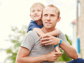 Son hugs his father — Stock Photo