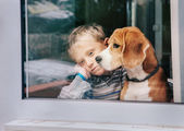 Sorrow little boy with dog — Stock Photo