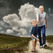 Son with father running — Stock Photo #49996541