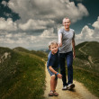 Son and dad walking   in the mountains — Stock Photo #50452789