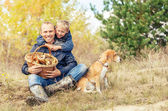 Family leisure in autumn forest — Stock Photo