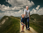 Son and dad walking   in the mountains — Stock Photo