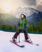 Little skier in mountain sky resort — Stok fotoğraf