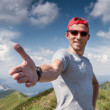 Man give hand on mountain footpath — Stock Photo #50800589