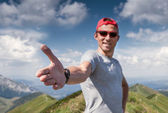 Man give hand on mountain footpath — Stock Photo