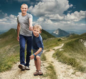 Son with father running on the footpath — Stock Photo