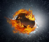 Burning puck with shards of ice — Stock Photo