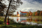 Castle by river in autumn — Stock Photo