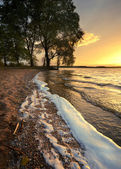 Waves of the lake at sunset — Stock Photo