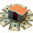 Toy house on banknotes — Stock Photo