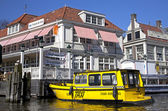 Yellow water taxi in Amsterdam, Netherlands — Stock Photo