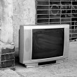 Old TV in front of flat - Stock Photo