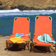 Lounger at the sandy beach — Stock Photo
