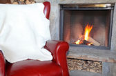 Fireplace and armchair — ストック写真